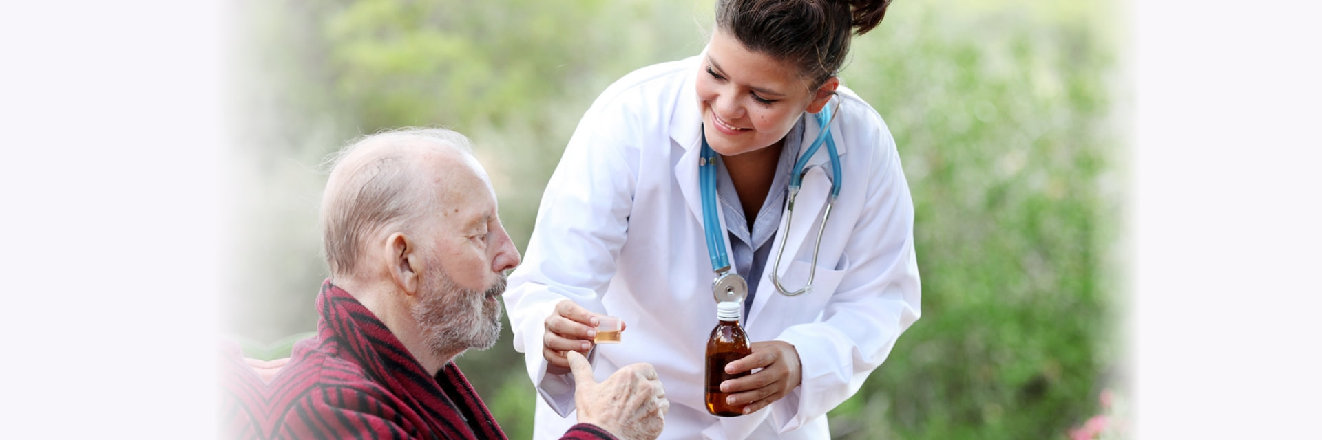 nurse giving elderly his medicine