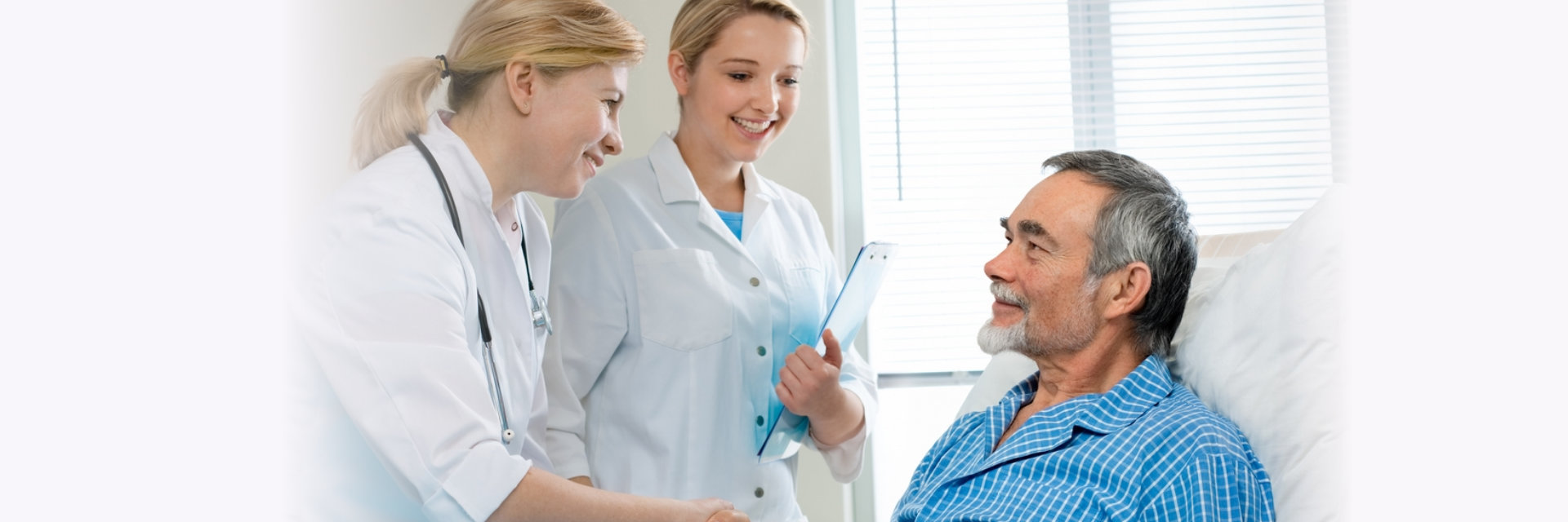 nurse and doctor visiting elderly man